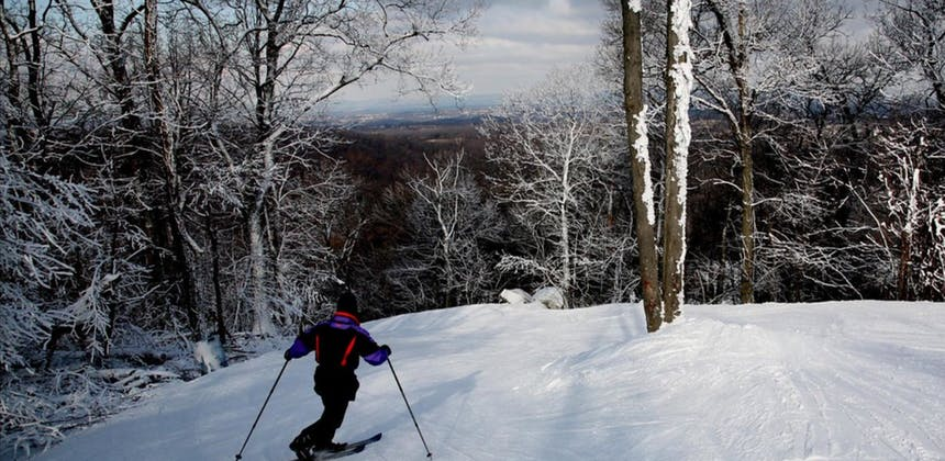 Skier at the top of a hill at Roundtop Mountain in Lewsiberry, PA