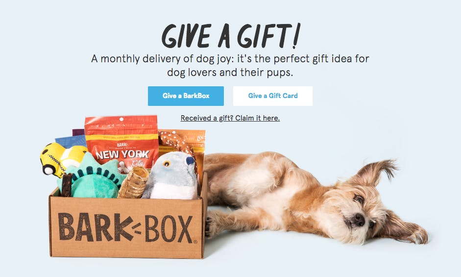 Bark & Co interface screenshot with a dog lying next to a Barkbox; Text reads: Give a Gift! A monthly delivery of dog joy: It's the perfect gift idea for dog lovers and their pups.