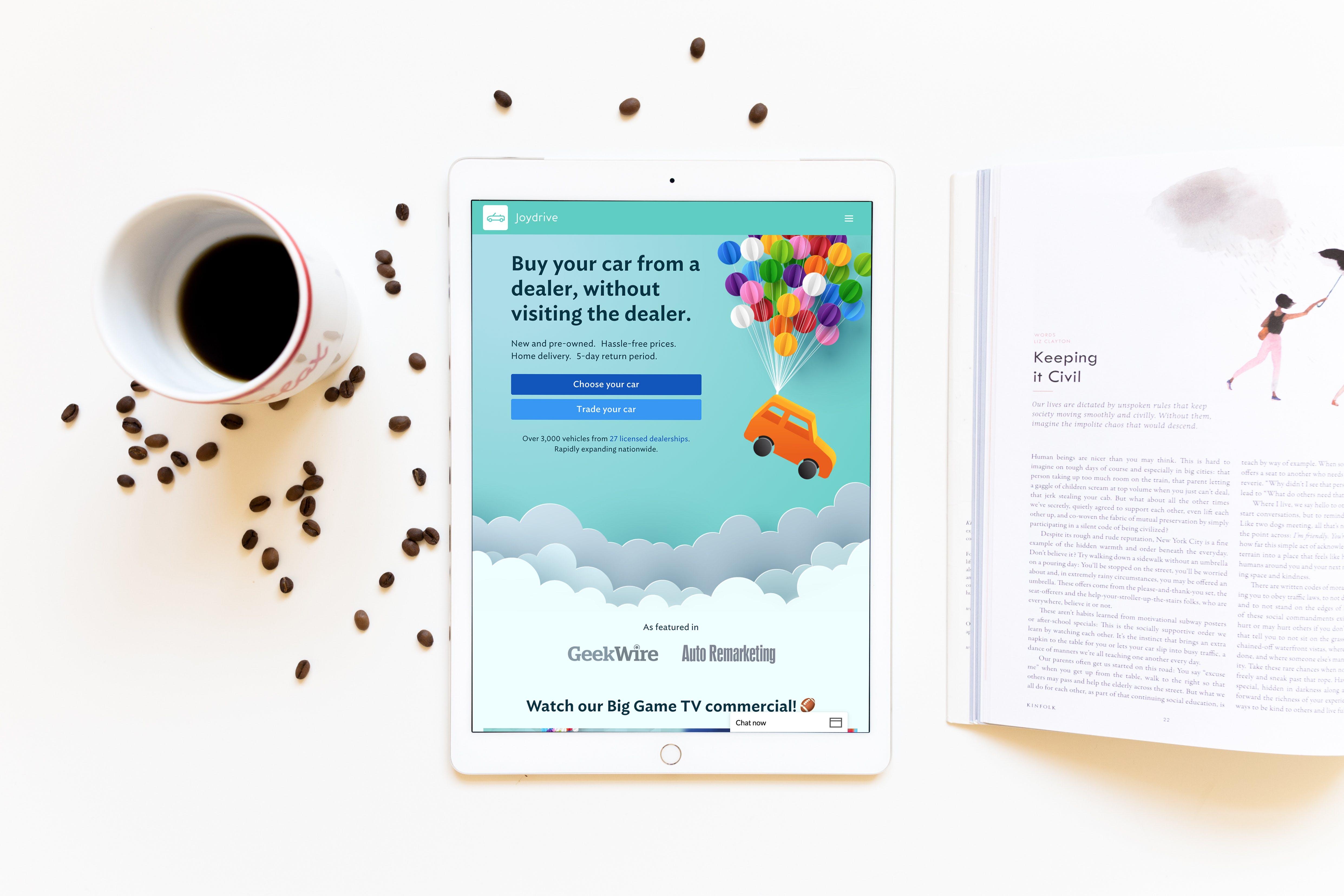 An iPad shows the Joydrive app