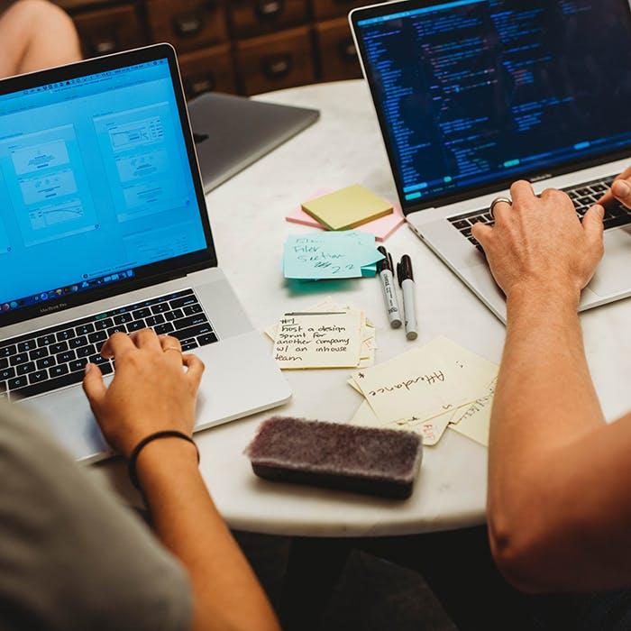 Designer and developer working side-by-side