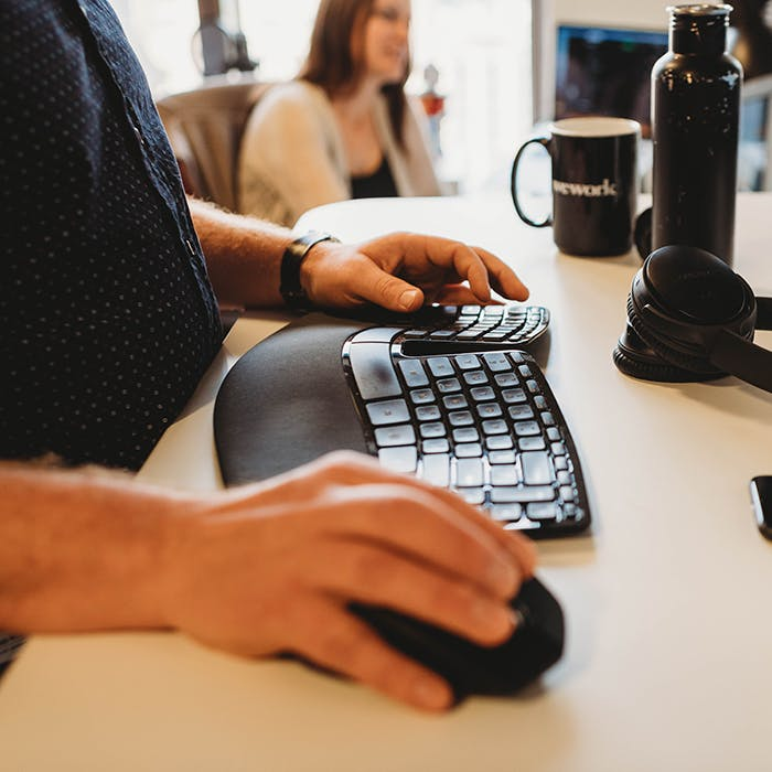 person using keyboard and mouse