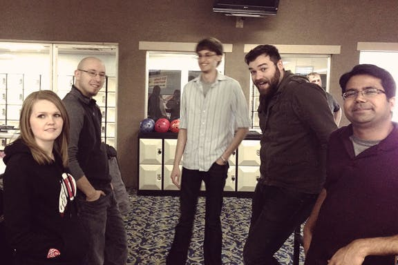 ThoughtLab employees at bowling alley