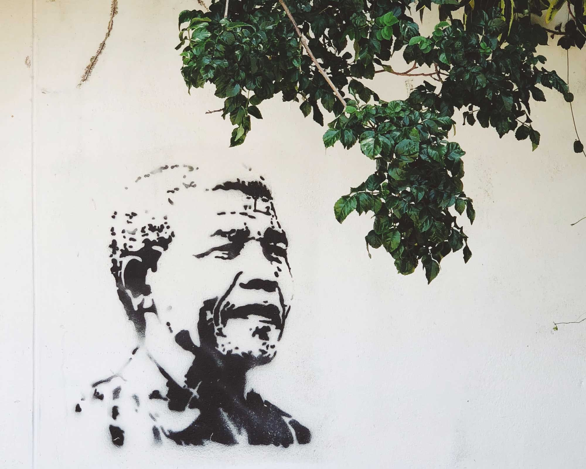 A street art painting of Nelson Mandela on a wall