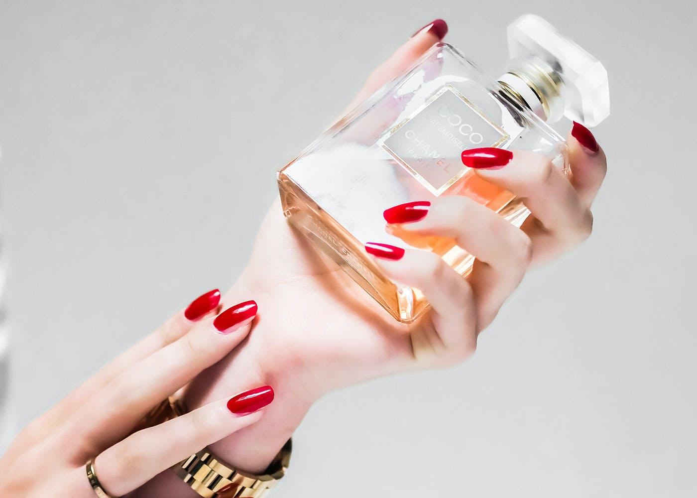 Woman modeling Coco perfume