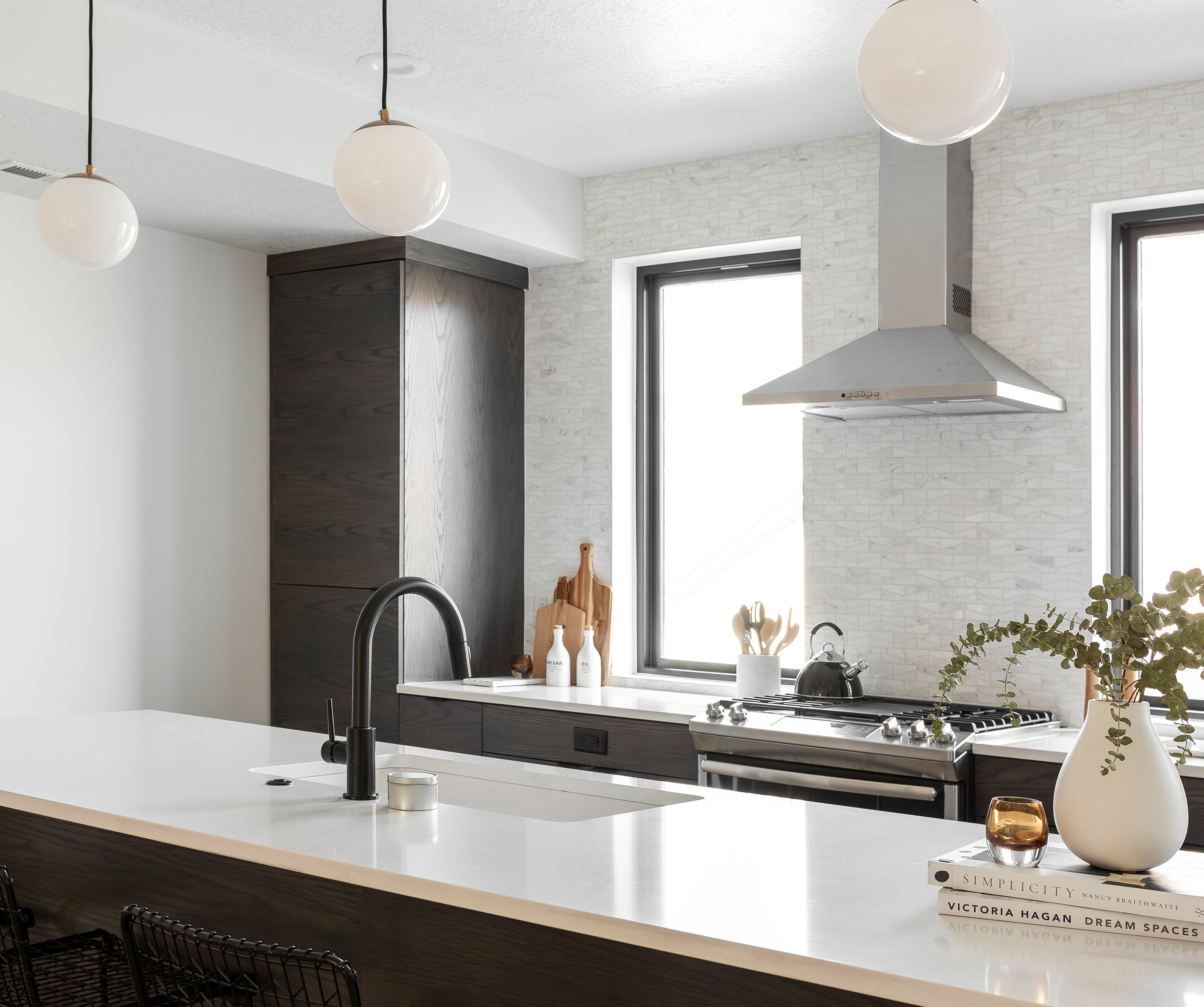 Inside the kitchen of a home by CW Urban