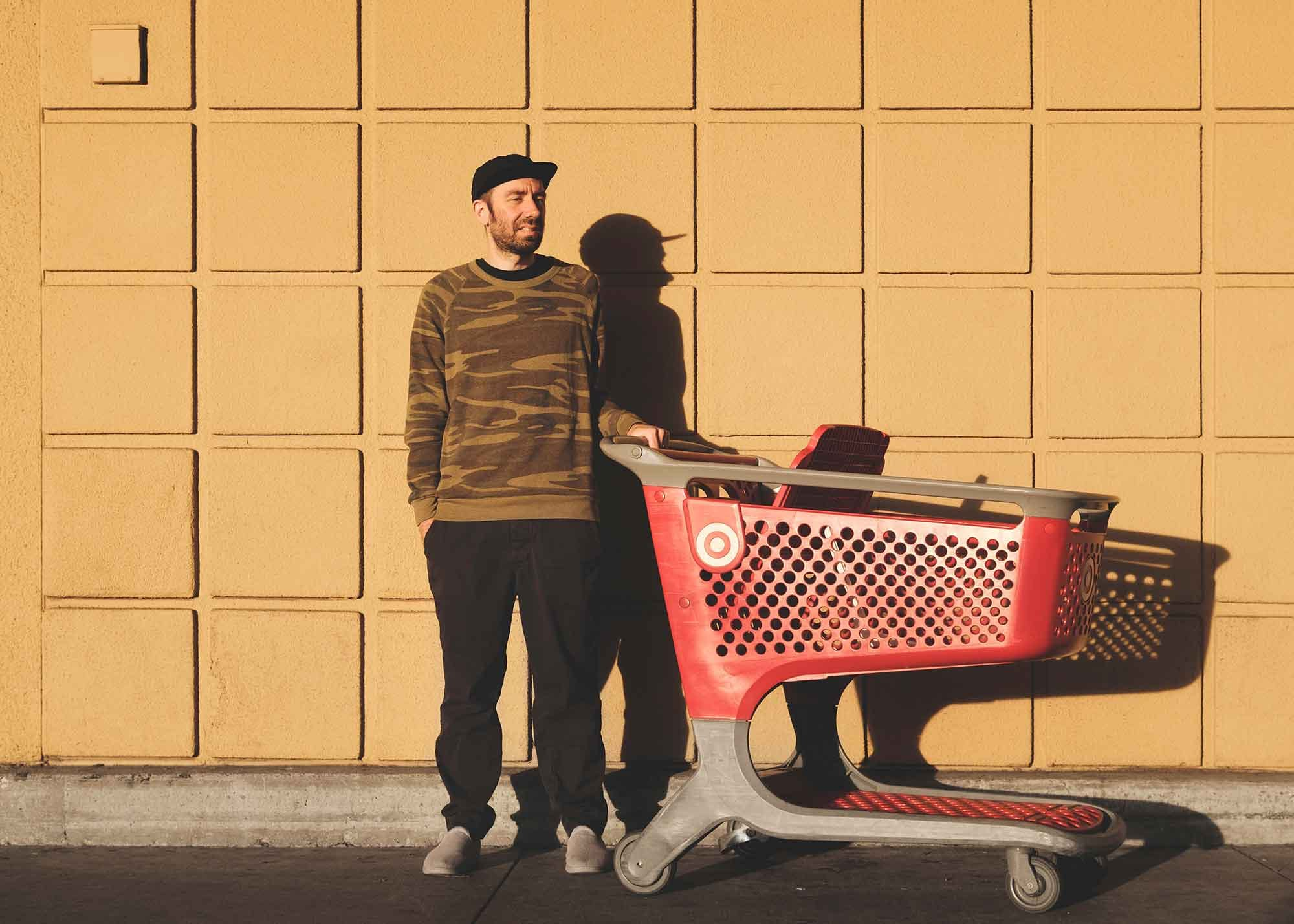 Yuppie pushing a Target cart