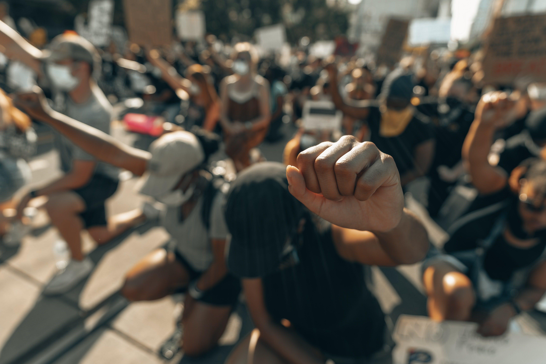 protestors kneeling with fist in air