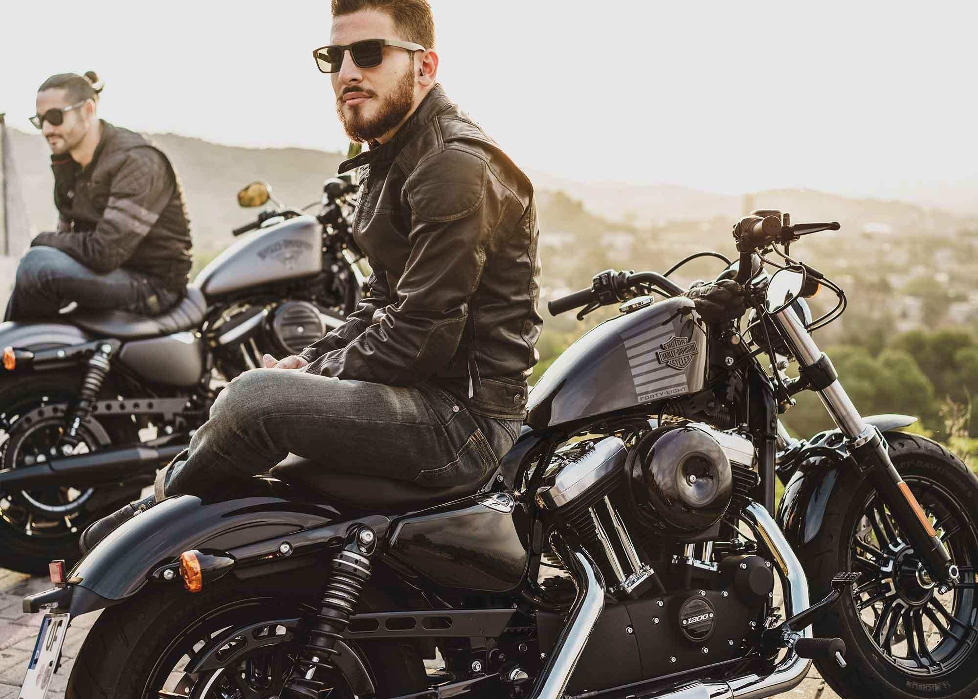 Men sitting on Harley bikes