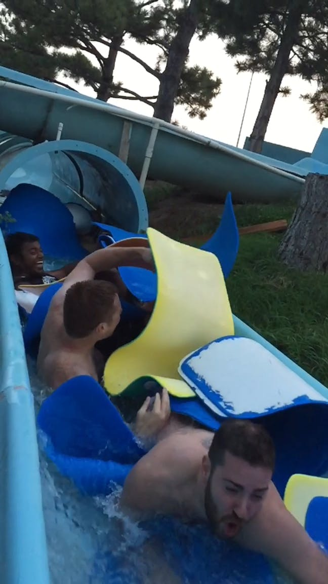 ThoughtLab team going down water slide