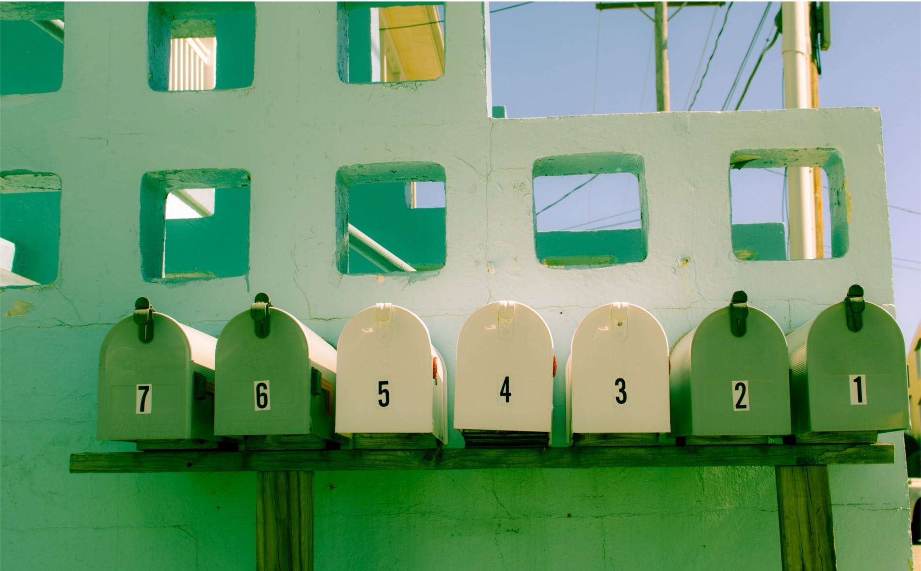green row of mailboxes