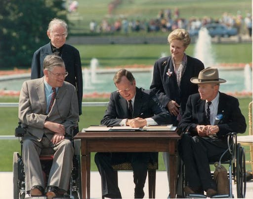 George bush signing the ada act