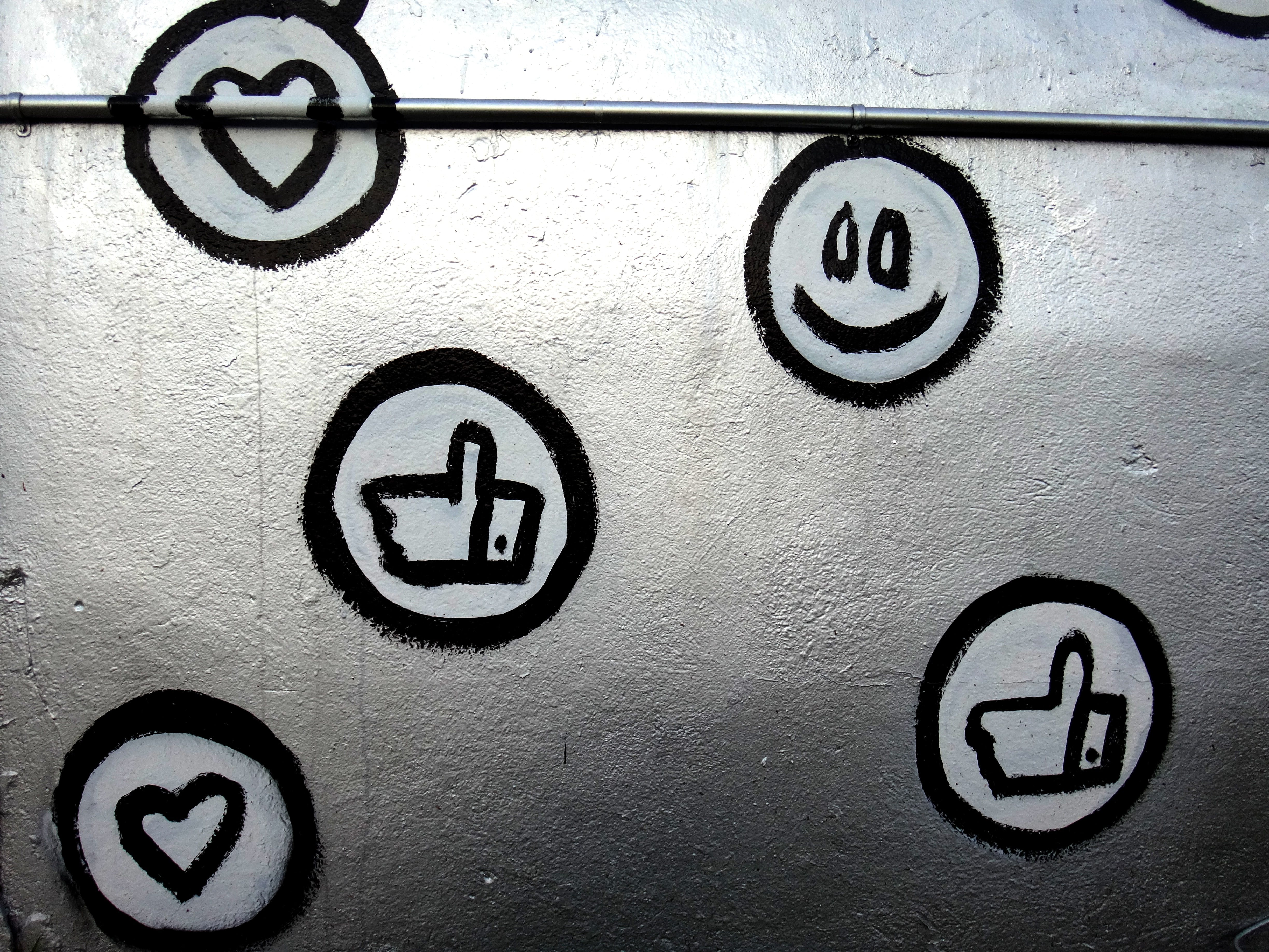 hand painted smiley faces, hearts, and thumbs up