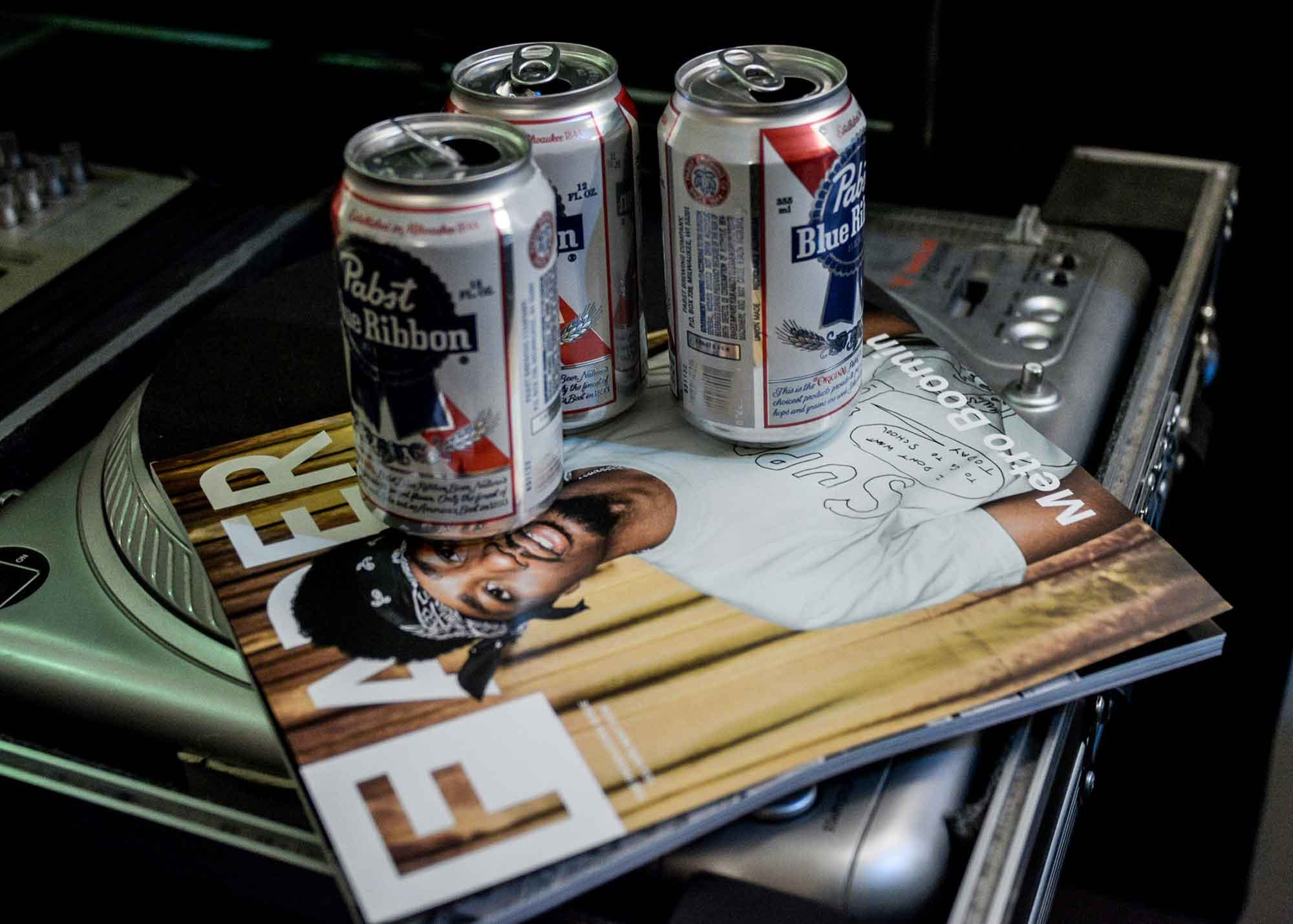PBR cans sitting on top of a record case