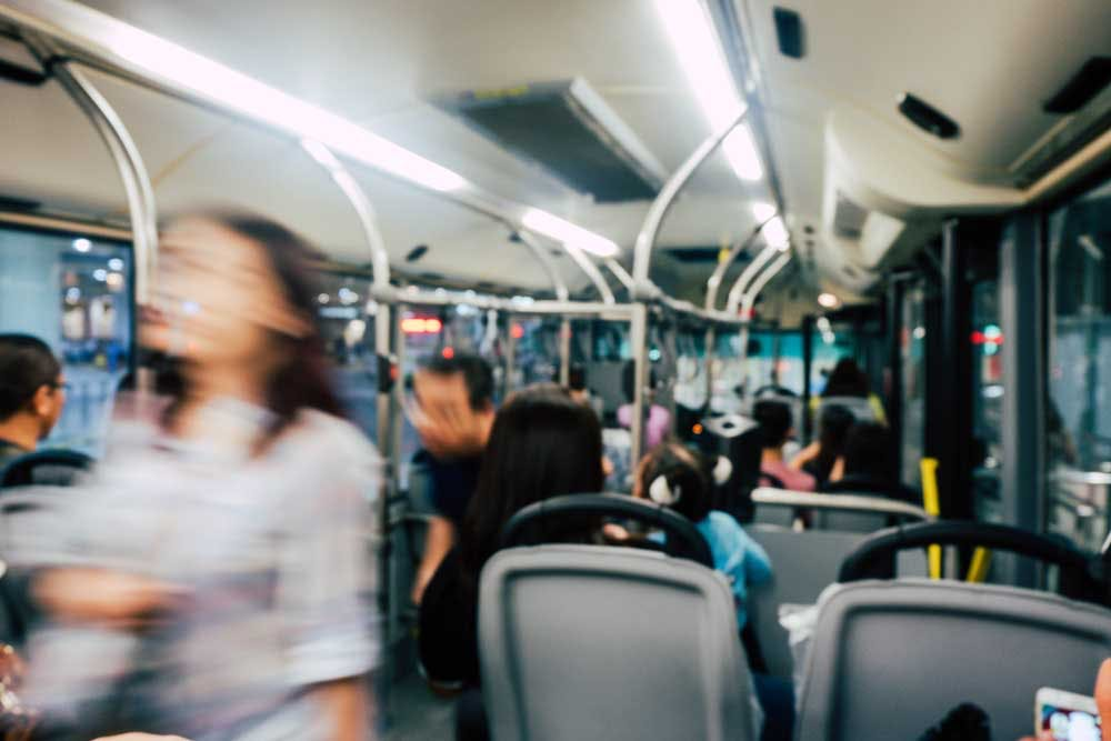 A crowded and blury bus