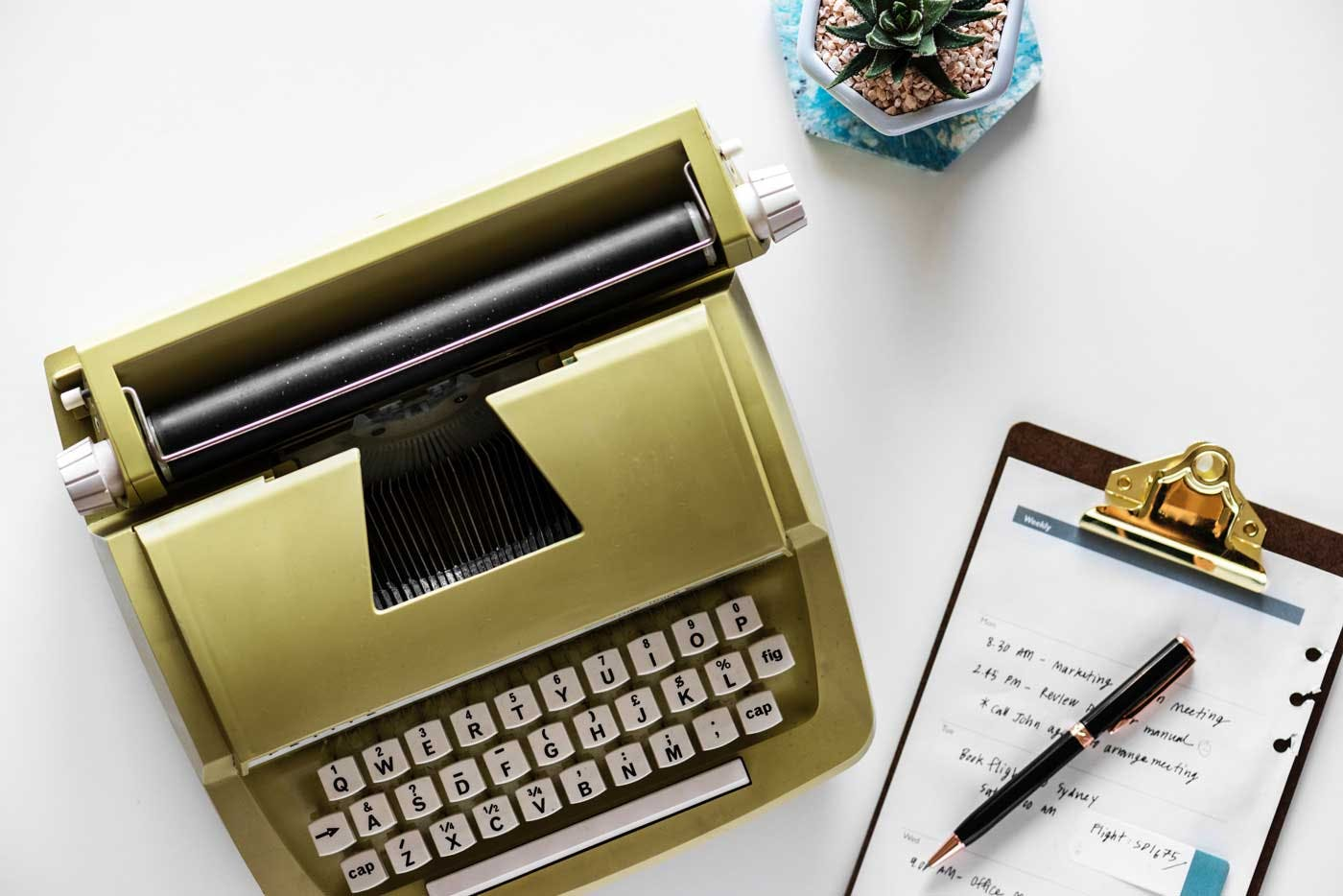 gold typewriter and clipboard