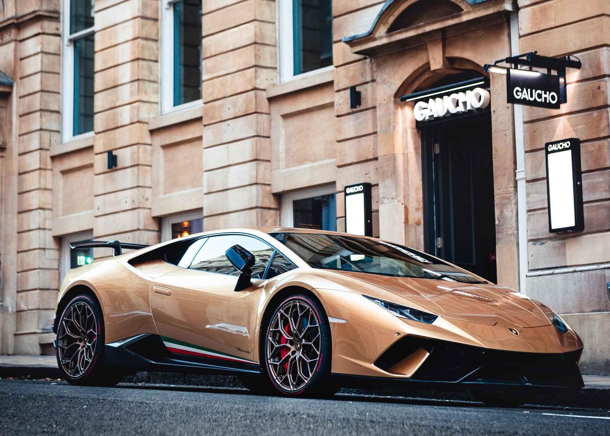 Luxury car parked in front of a luxury goods store