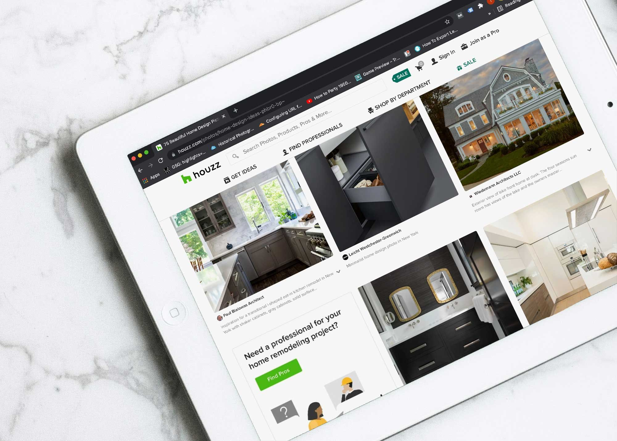 Houzz interior design social media platform showing on a tablet