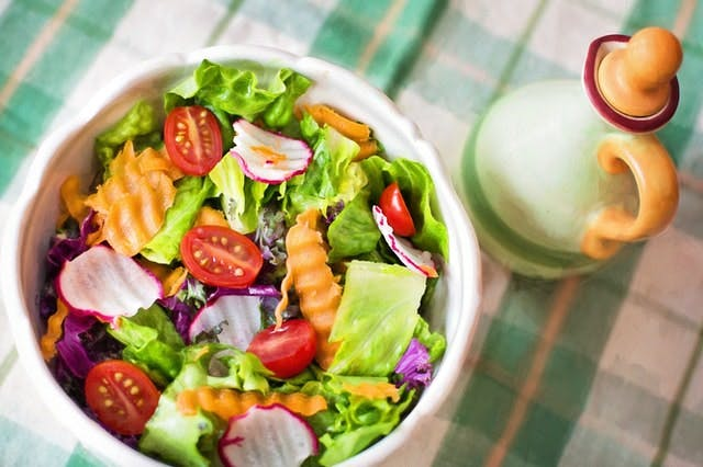 bowl of salad on checkered table cloth