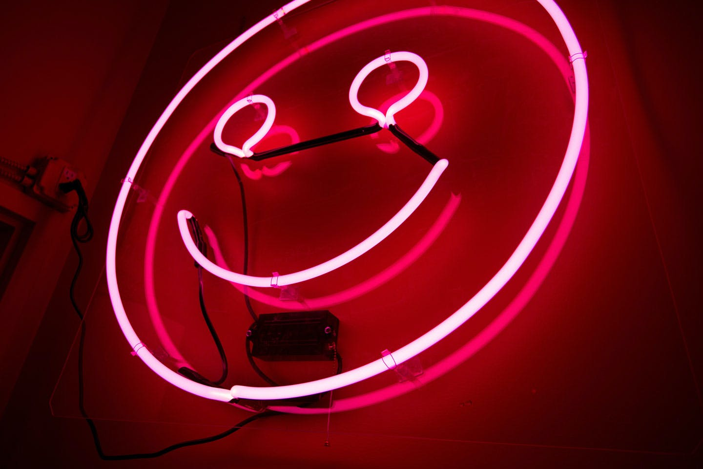 pink neon smiley face sign