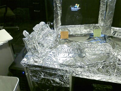 desk wrapped in foil