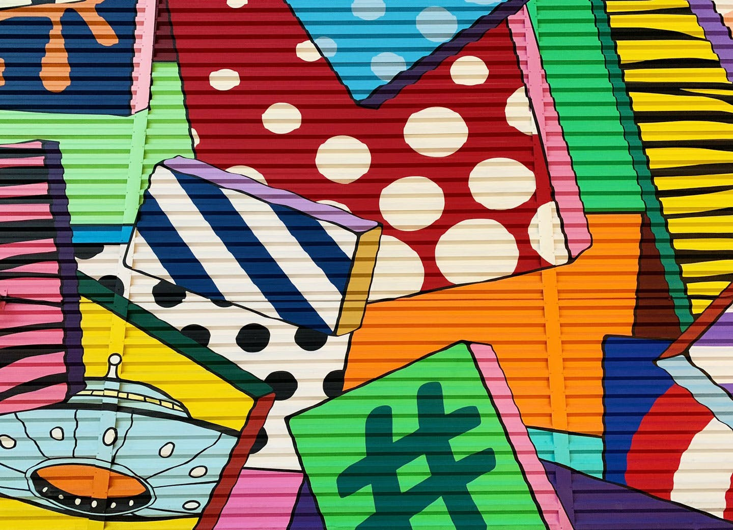 colorful graffitied patterned tiles in a collage