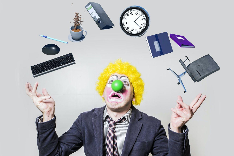 clown juggling office supplies