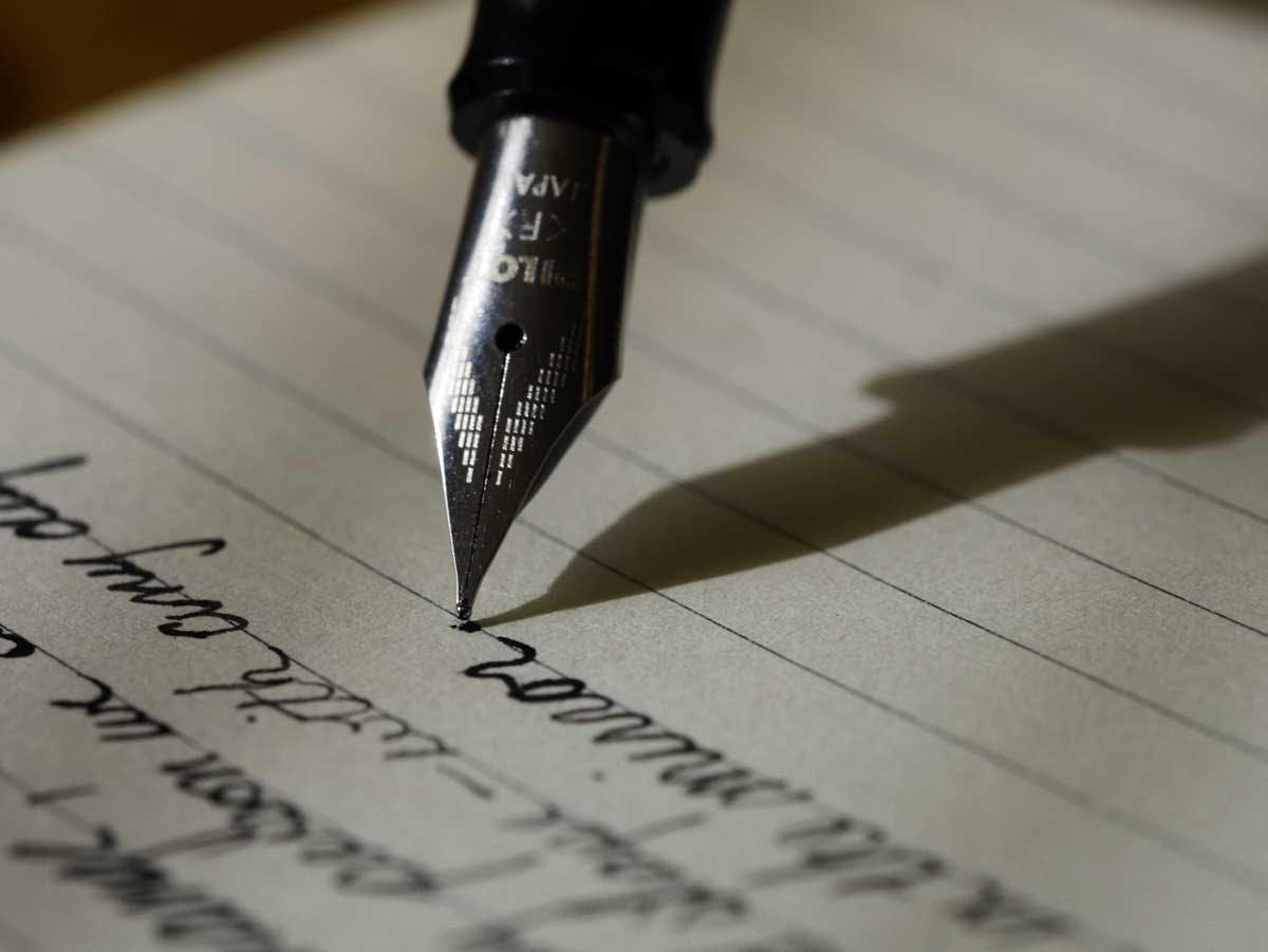 a closeup shot of a fountain pen on paper