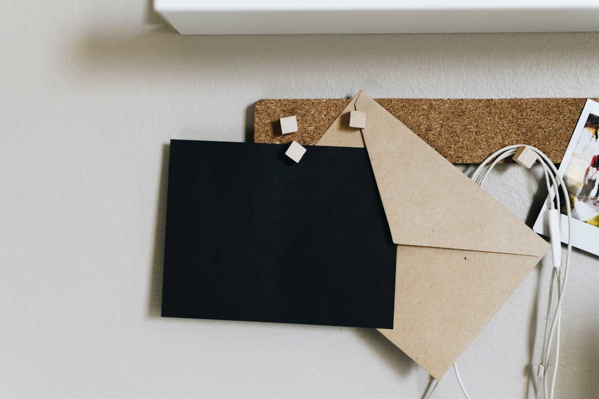 a letter being saved on a corkboard