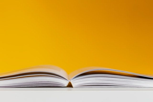 open book against yellow background