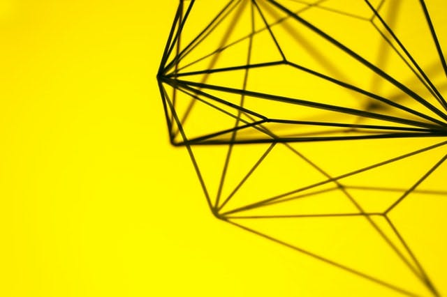 geometric diamond on yellow background