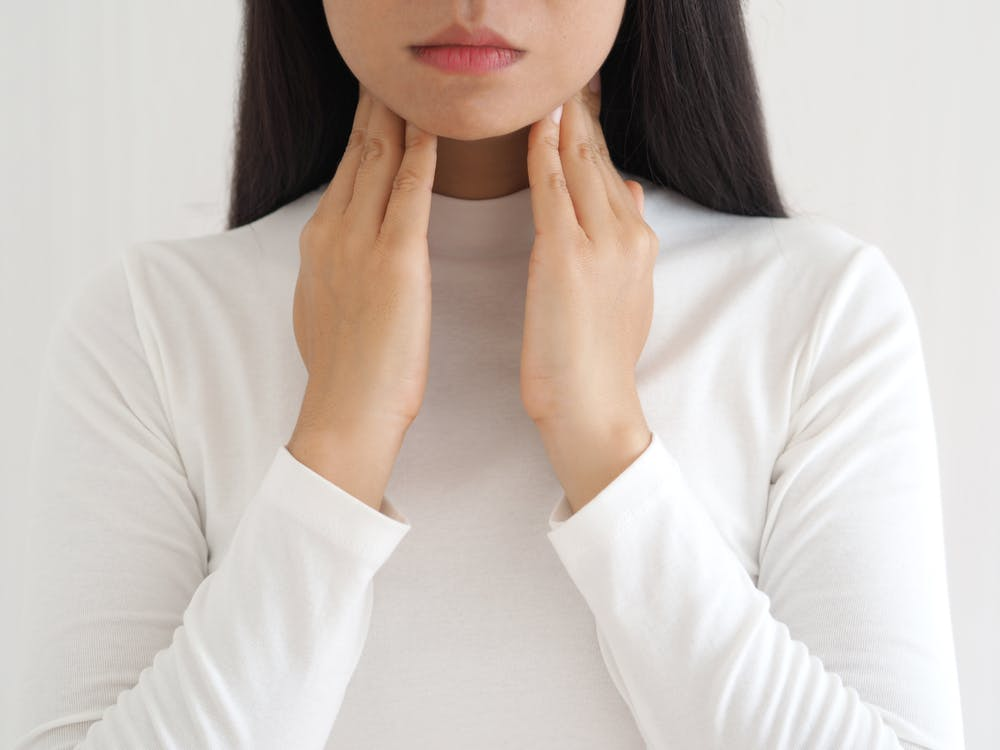 Thyroid on woman's neck.