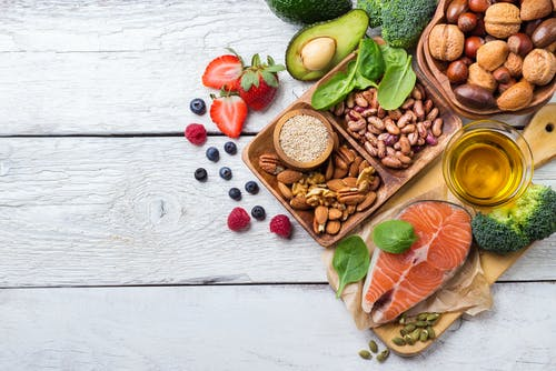 Best foods to lower your cholesterol — oily fish, avocados, nuts, and fruits.