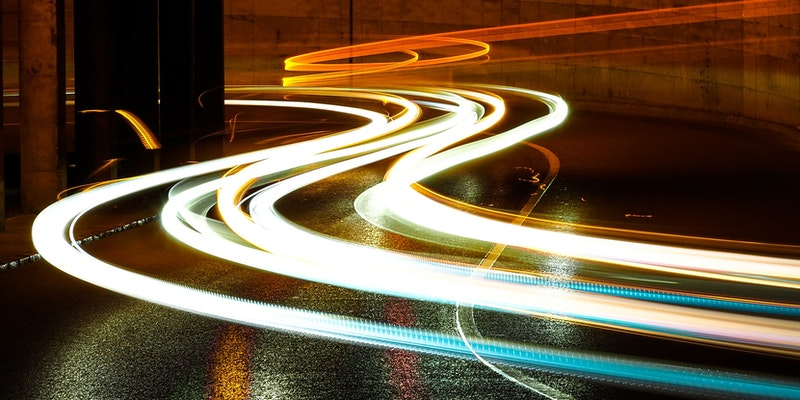 photographic long exposure of cars traveling thru a tunnel. Titled - Lights in the night. By Marc Sendra Martorell - https://unsplash.com/@marcsm