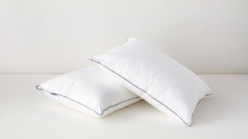 2 down alternative pillows, one stacked on the other
