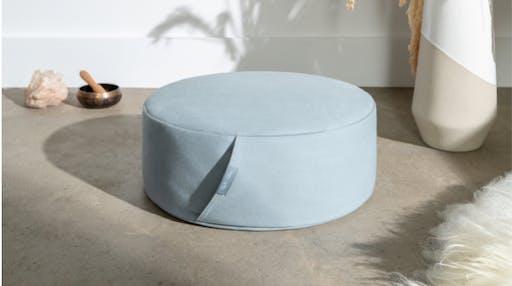 Meditation Cushion on a concrete floor.