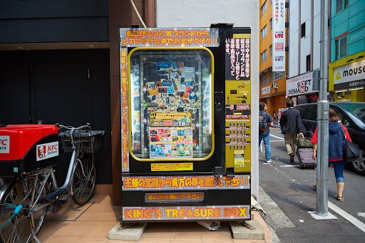 A Japanese vending machine that sells mystery boxes full of various prizes.