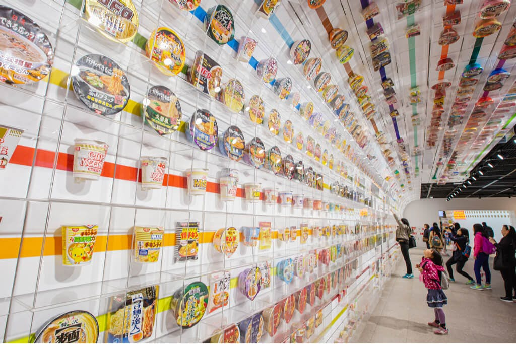 A line of many different ramen brands and flavors at a station in Osaka.