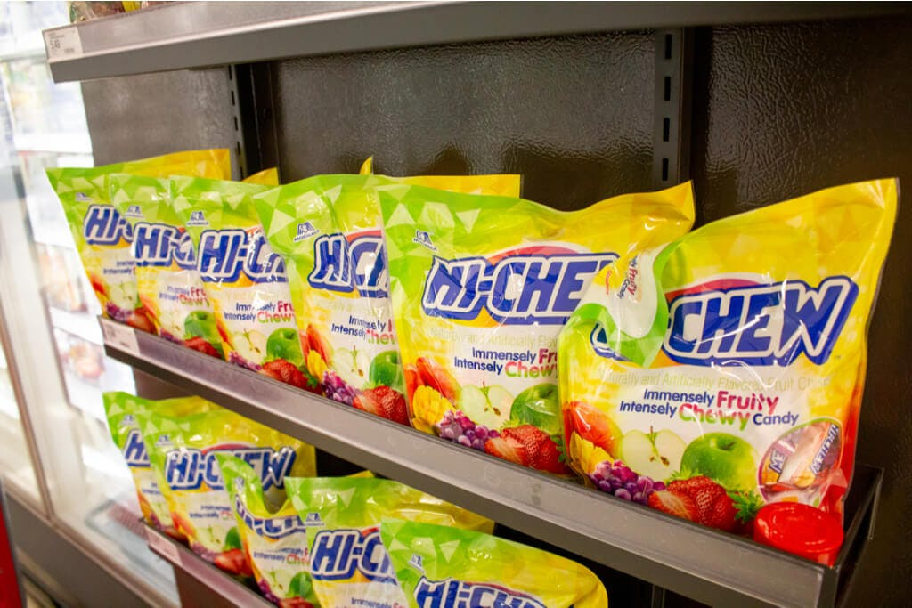Large packs of Hi-Chew on two shelves in a supermarket in San Jose, CA.
