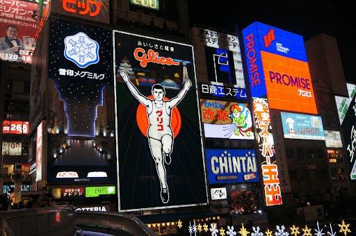 The iconic Glico man illuminating the Dotonbori district of Osaka, Japan