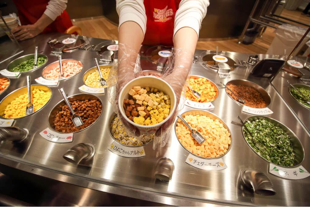The make-your-own cup noodle bar with many toppings and extras at the Ikeda ramen museum in Osaka