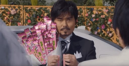 Tooru san holding gummy candy from the famous long long man commercial
