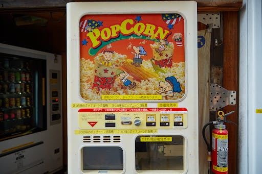 A Japanese vending machine that sells popcorn.