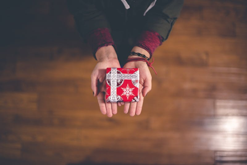 A pair of hands holding a gift