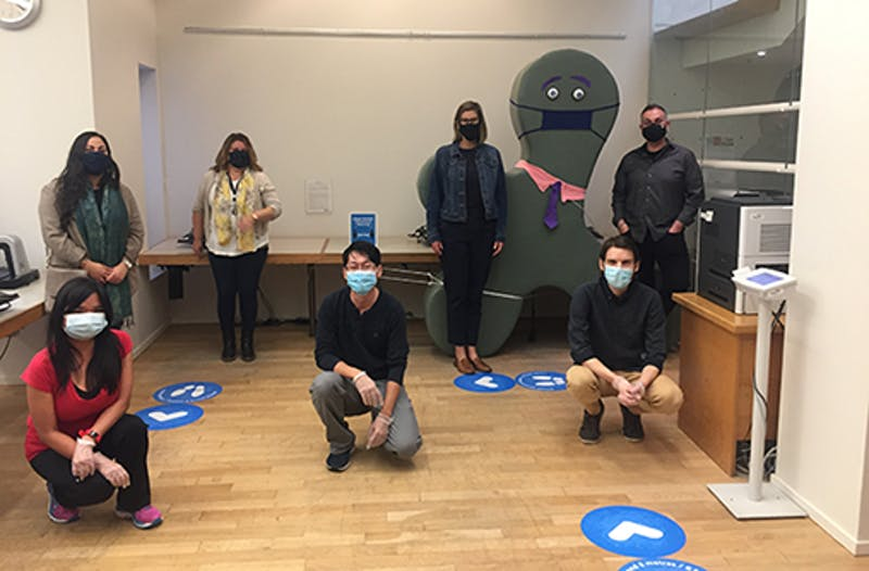 Library staff wearing masks inside branch