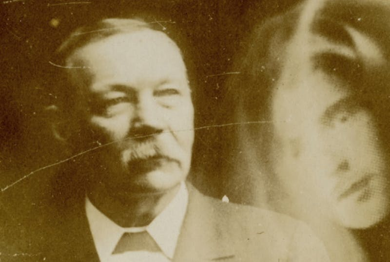 Photo of Arthur Conan Doyle and a haunting apparition