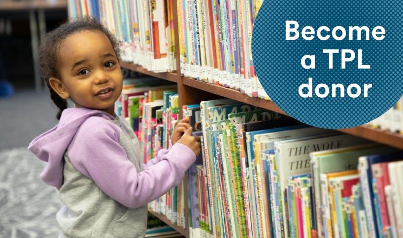 Kid grabbing a library book