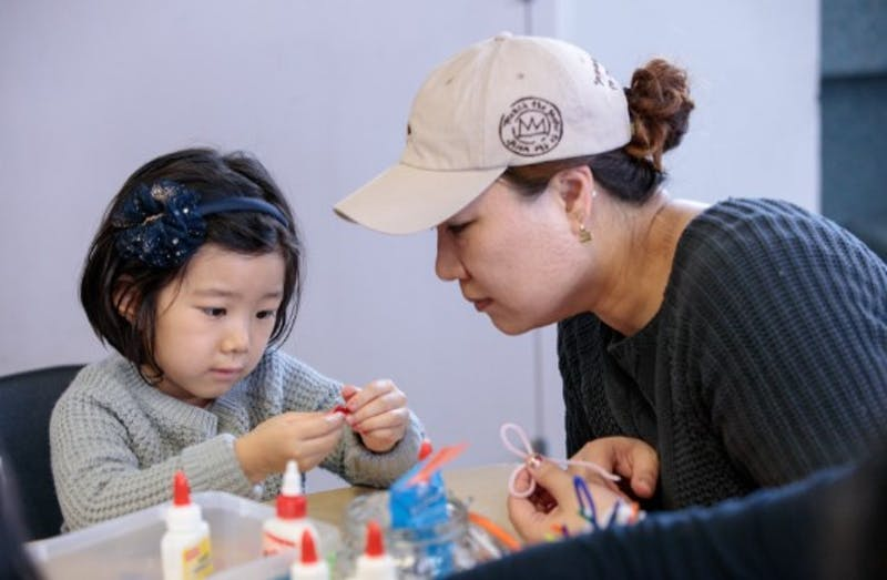 Mother and child working on a craft together
