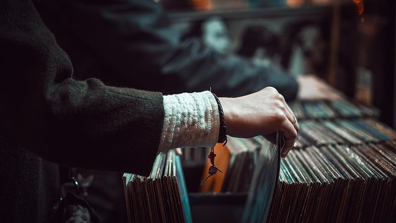 Person browsing in record store