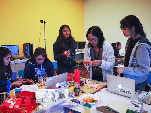 Teens making alternative game controllers