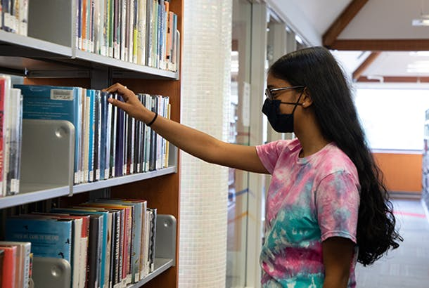 Teen browsing while wearing a mask